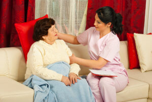 caregiver comforting the old woman